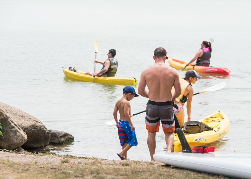 A family launches their kayaks at Kershaw Park in Canandaigua