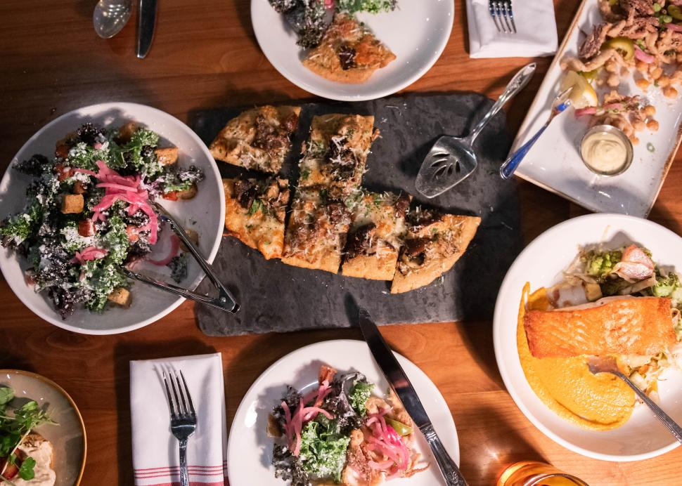 Overhead photo of a table full of food from Kindered Fare in Geneva
