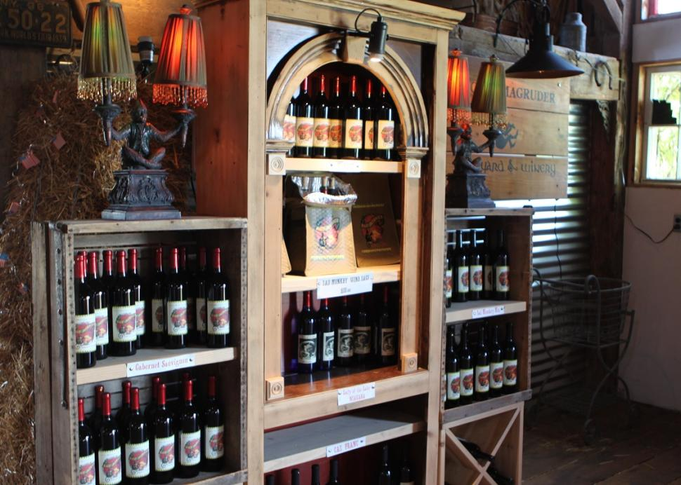 A shelf holds bottles of wine available for purchase inside of Lacey Magruder Vineyard and Winery