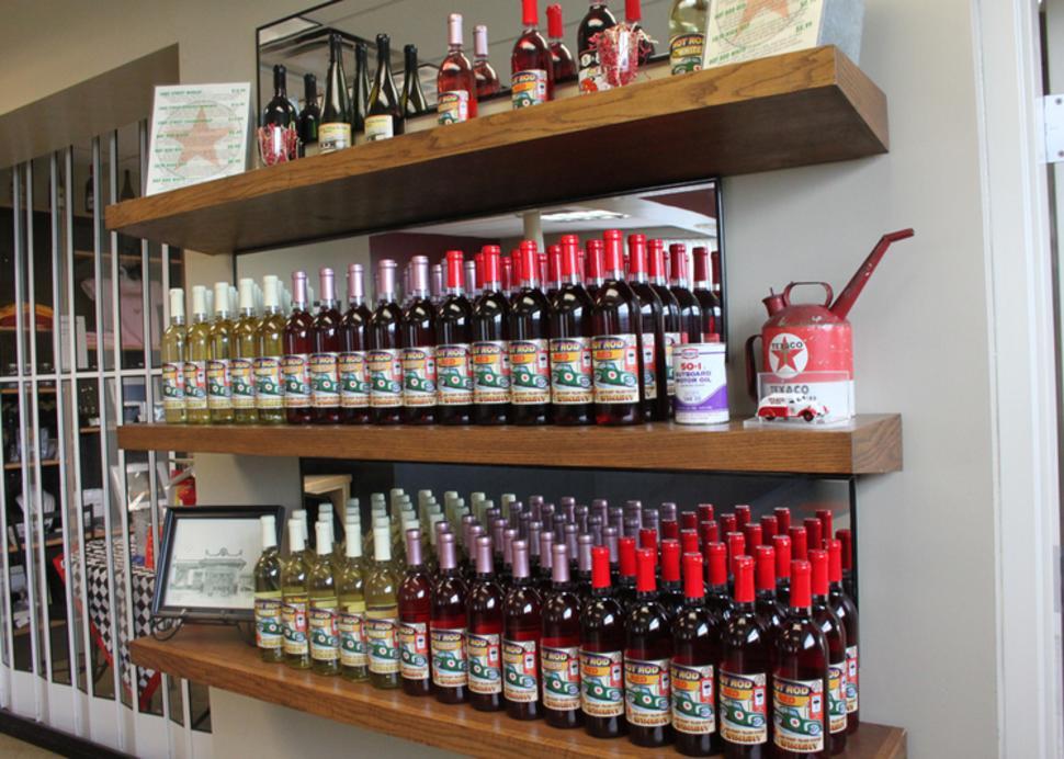 Photo of wine bottles on a shelf at Lake Street Station Winery in Geneva