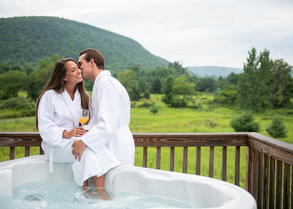 A couple sits in a Jacuzzi overlooking the Bristol Hills at mountain horse farms