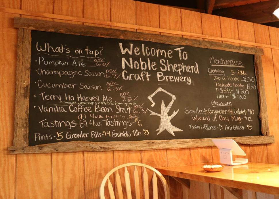 A blackboard sits filled with notes inside of the Noble Shepherd