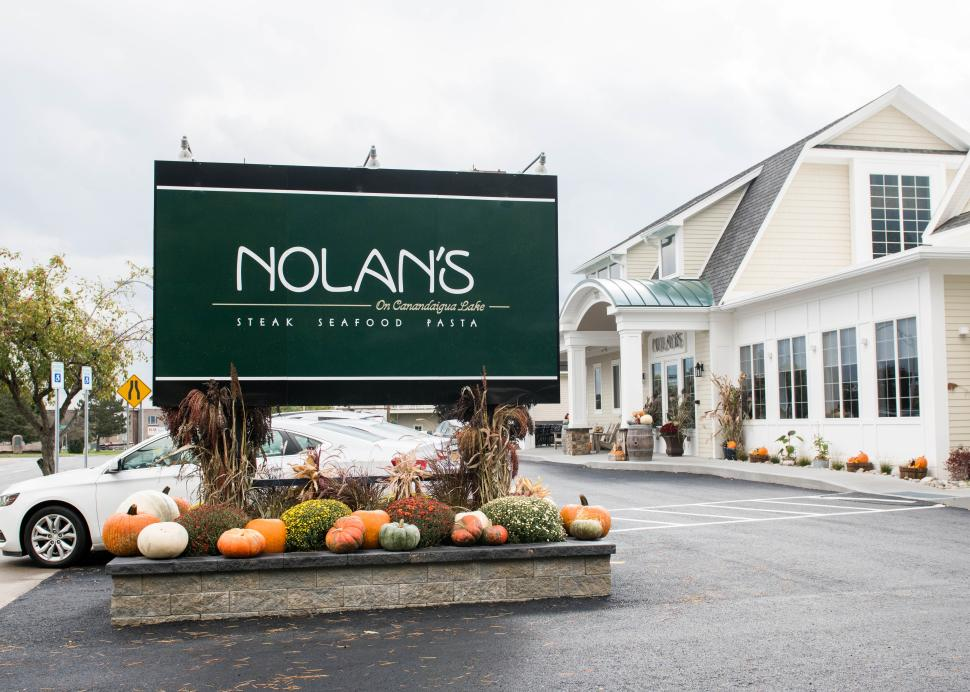 The exterior sign for Nolan's in Canandaigua