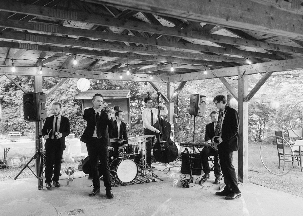 The wedding band plays under a pavilion at the Cummings Nature Center
