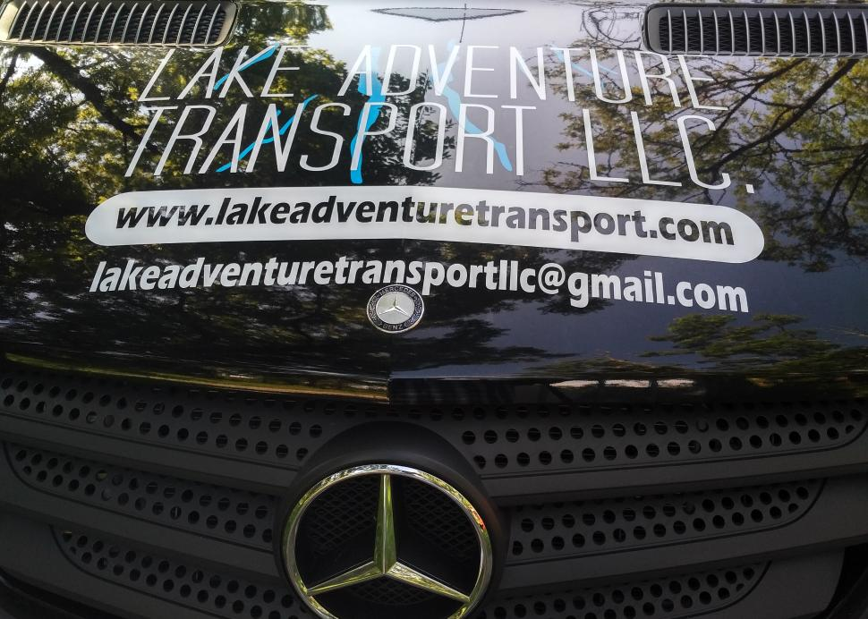 Closeup of the logo on the front of the Lake Adventure Transport Van