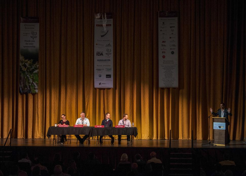 A table holds four speakers during an event at the Smith Center for the Arts