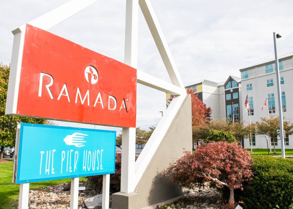 Exterior sign for The Ramada Geneva Lakefront Hotel