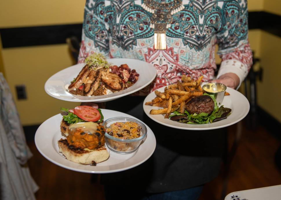 Three plates of food sit waiting to be eaten at Roots Cafe in Naples