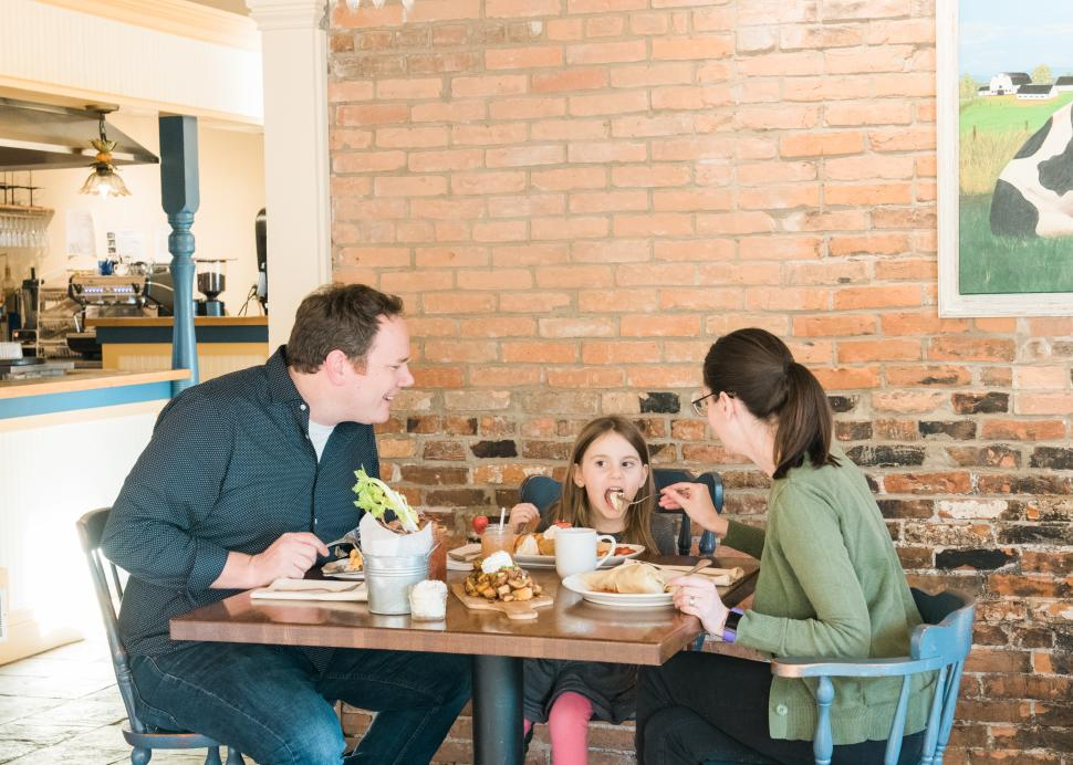 A family enjoys a meal at Simply Crepes in Canandaigua