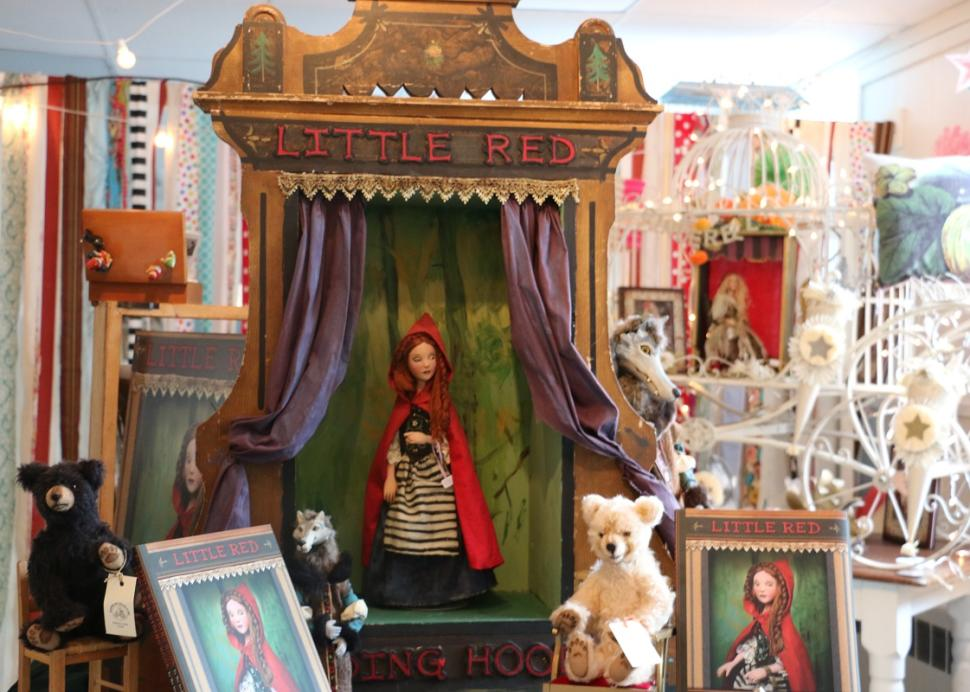 Dolls stand posed inside of True Lily in Canandaigua