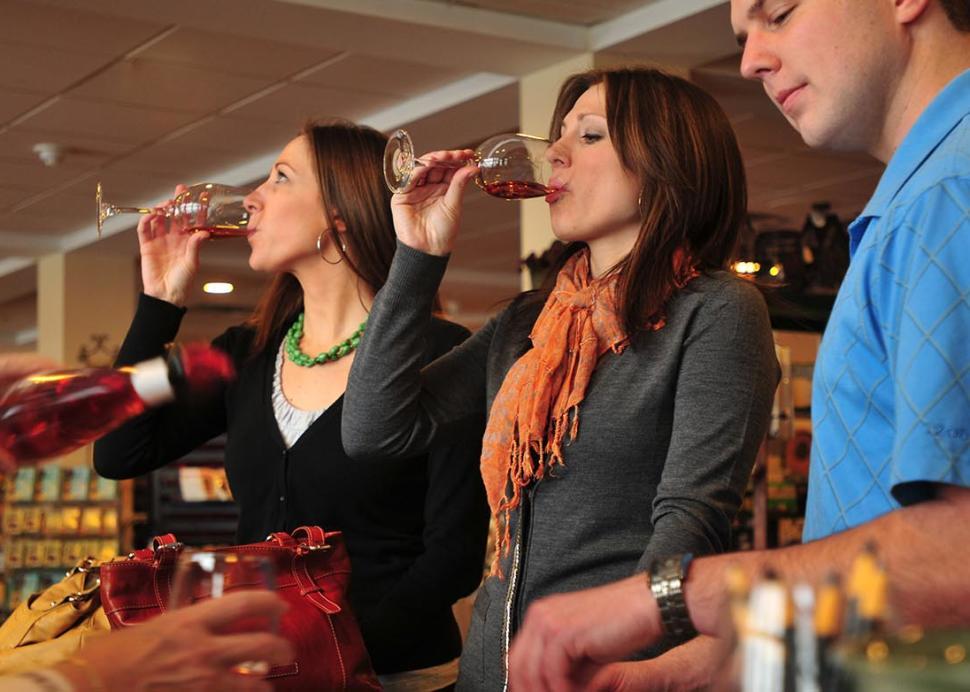 Group tasting wines at the bar