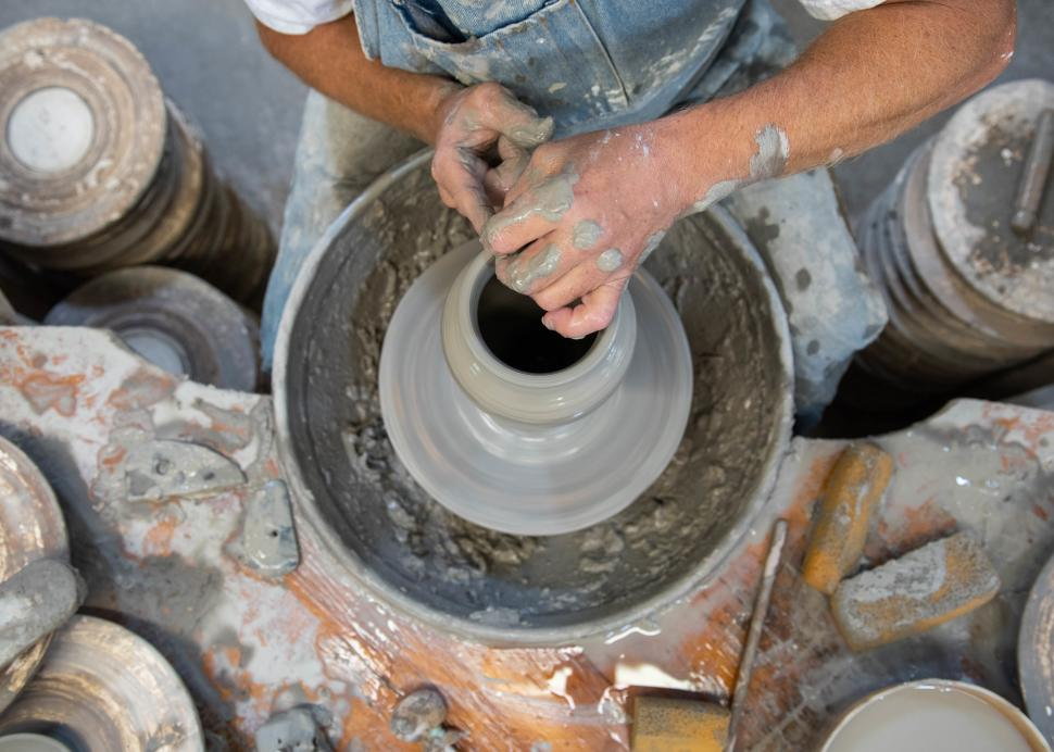 A man spins pottery at the Wizard of Clay in Bloomfield