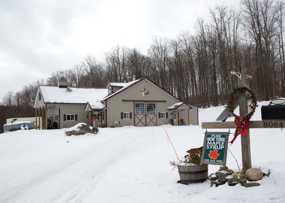 Exterior of the Wohlshlegel's Naples Maple Farm in Naples covered in snow during the winter