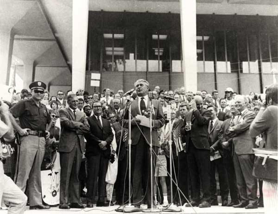 This image is of a news conference on the 1969 Lunar Landing Celebration in front of the Courthouse.