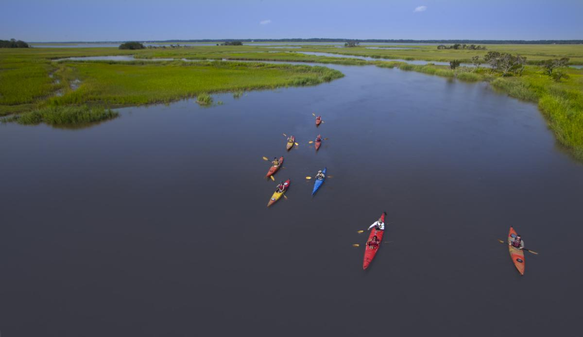 A group of kayakers paddle through the marsh in Golden Isles, Georgia