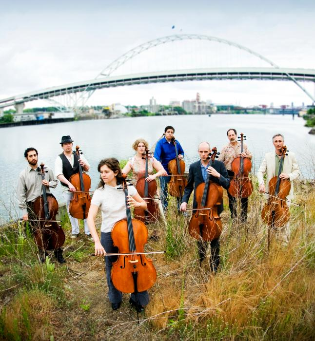 Portland Cello Project group by the river