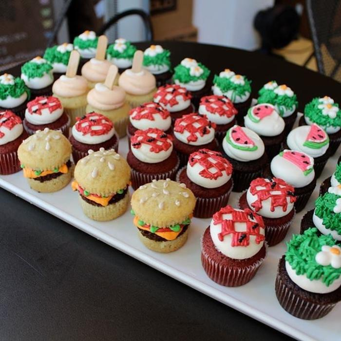 Tray of picnic-themed cupcakes
