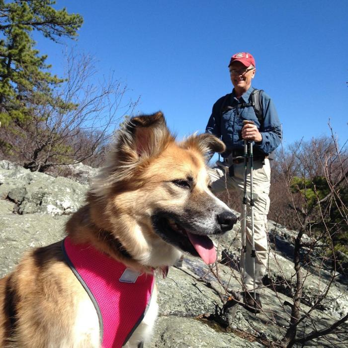 Hiker with his dog on a Frederick hiking trail