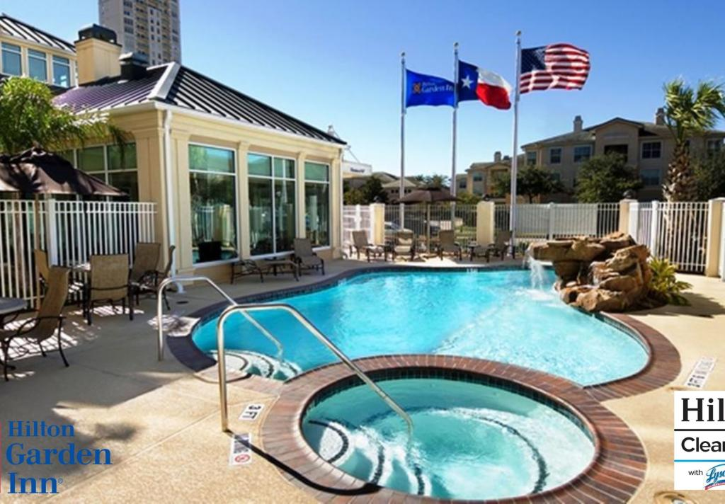 HGI Galleria Pool With Hilton Lysol CleanStay Logo