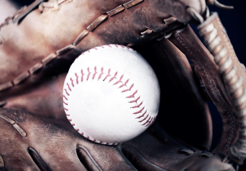 The Whitehall Old Vintage Baseball In Glove Stock Photo