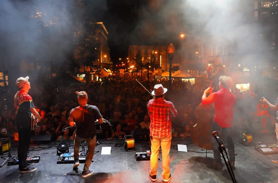 view from stage of men playing music at a street concert in covington ky