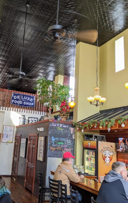 photo of the interior and bar at Elusive Cow restaurant in Bellevue, Ky.