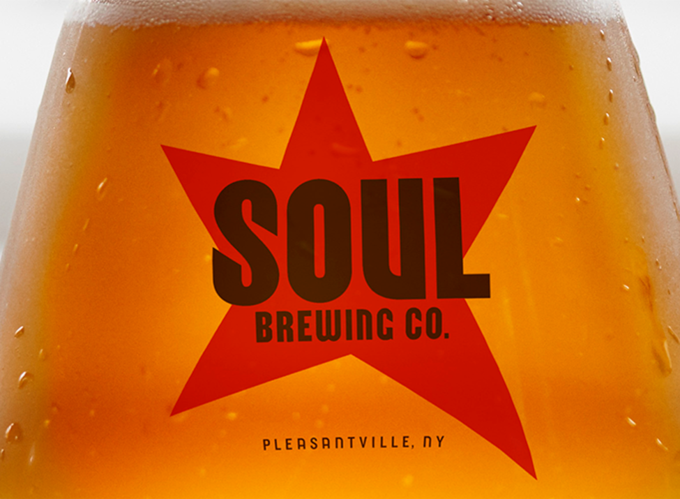 Soul Brewing Co. glass of beer with logo
