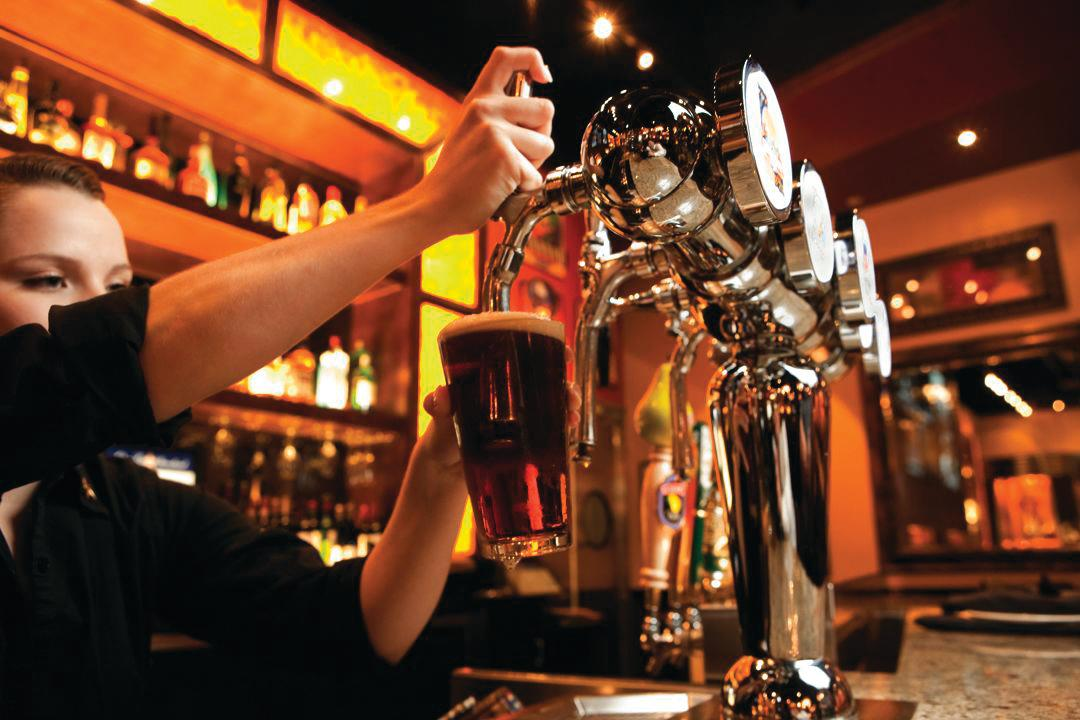 Man Pouring Beer At BJ's Restaurant & Brewhouse
