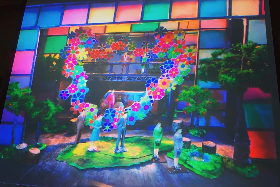 The flower power set of As You Like It at Royal Manitoba Theatre Centre.