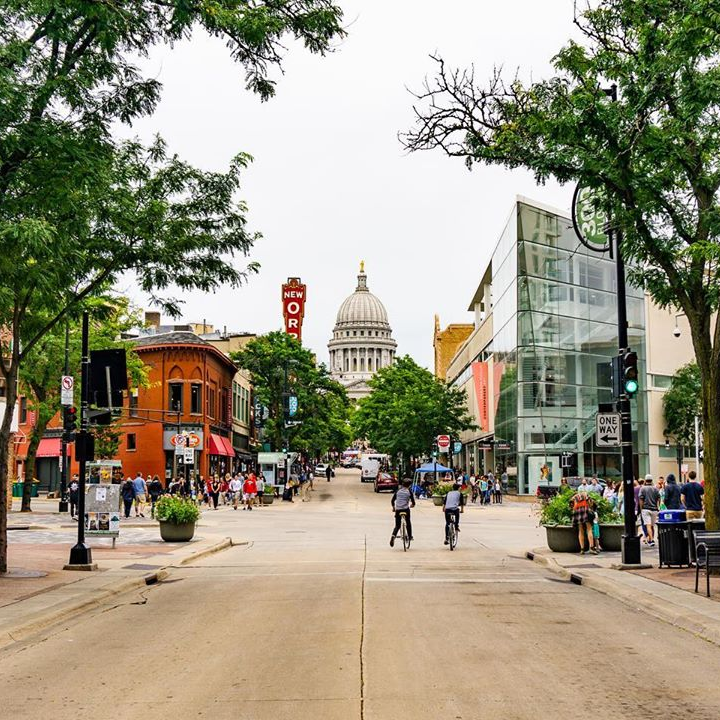 A view of State Street with the Wisconsin State Capitol in the background
