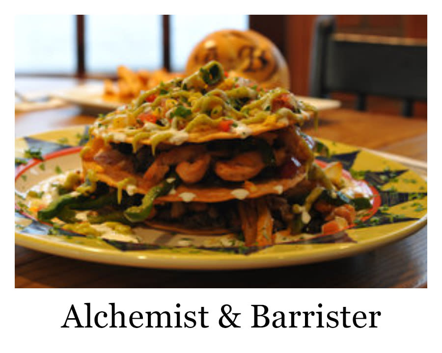 A plated meal from Alchemist and Barrister with layered tortillas