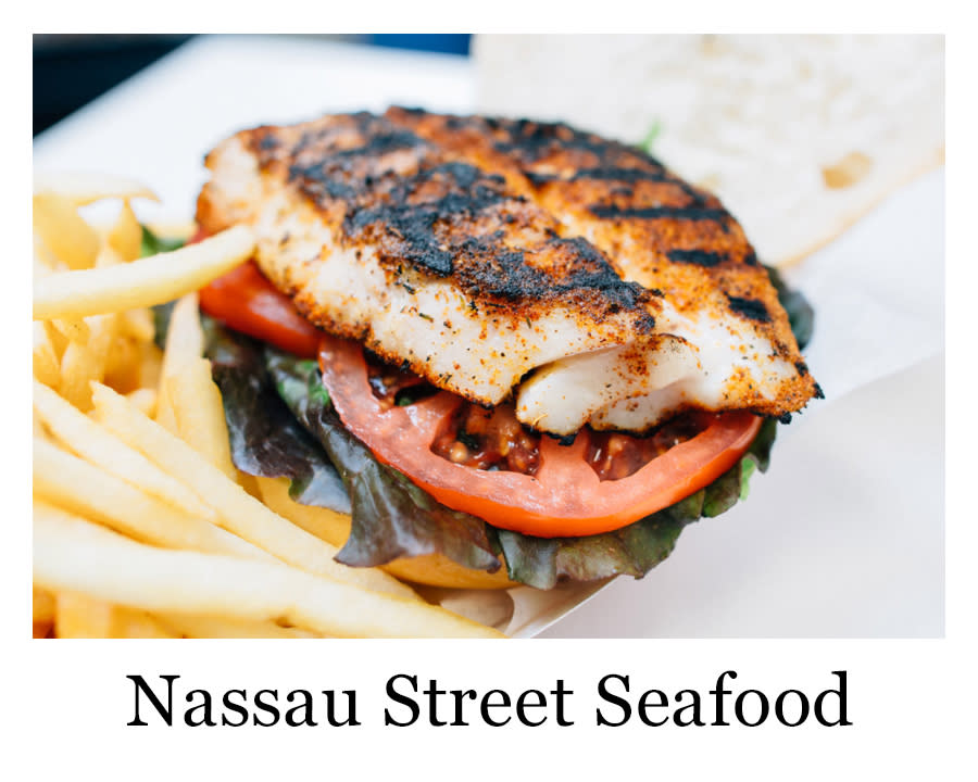 A fish sanwich with french fries from Nassau Street Seafood