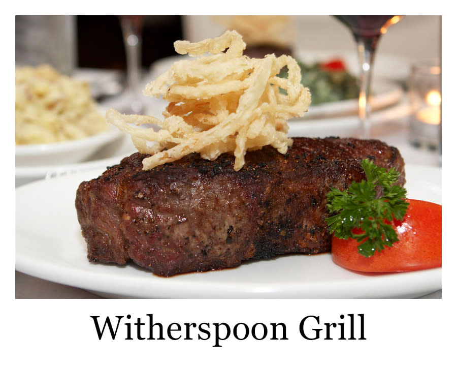 A steak with stacked fried onions from Witherspoon Grill