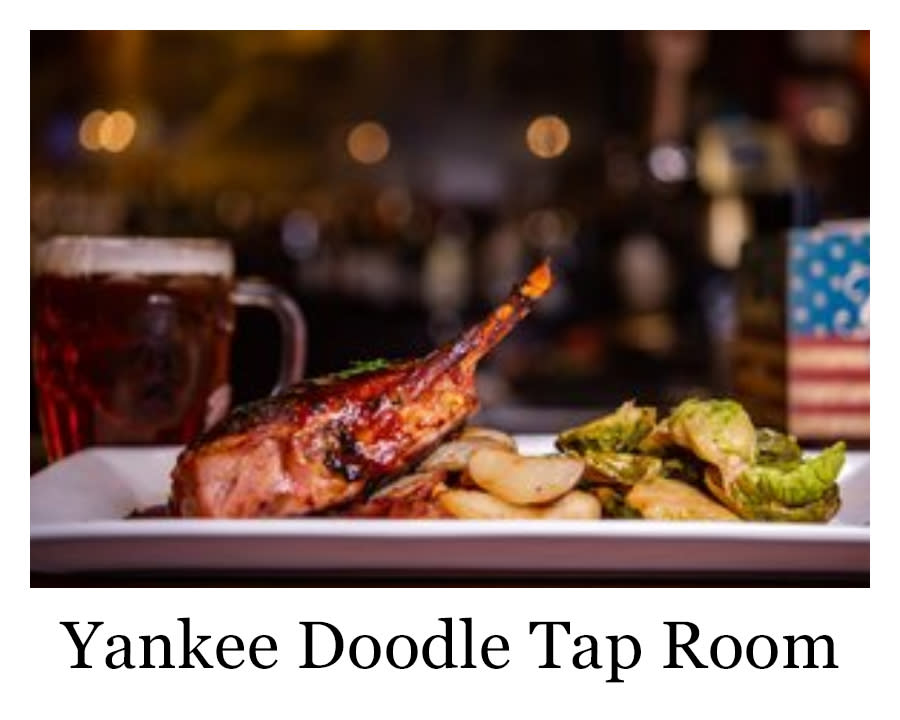 a steak with veggies and a beer from Yankee Doodle Tap Room