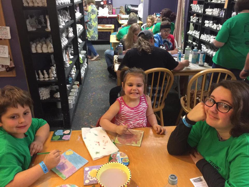 Kids coloring their clay at Clayfish Bisque