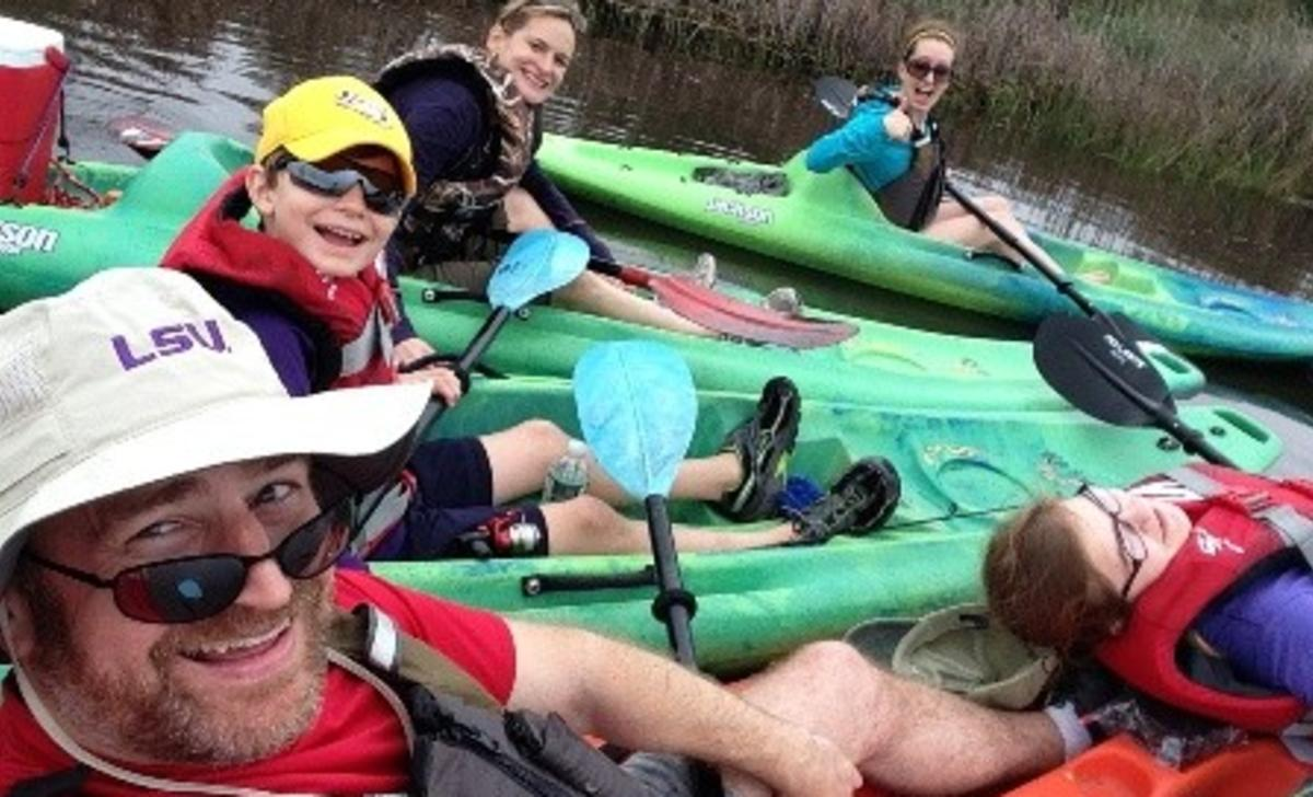 Family kayaking on Bayou Adventure in Louisiana Northshore