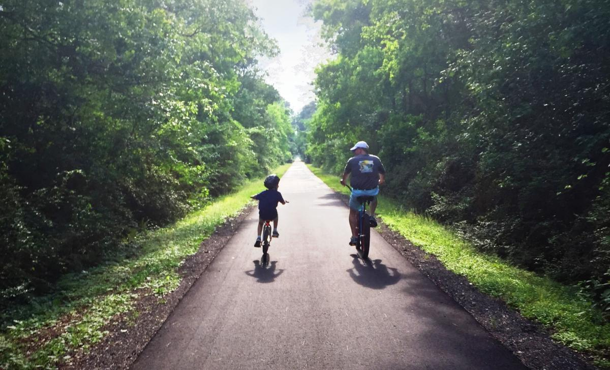 Father and Son Cycling the Tammany Trace in Louisiana Northshore
