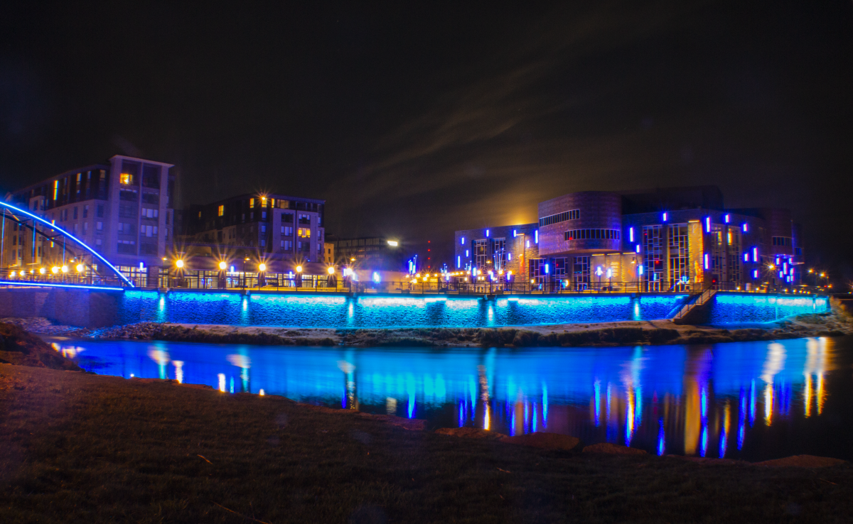 Pablo Center at the Confluence exterior With Blue Lights On The Water