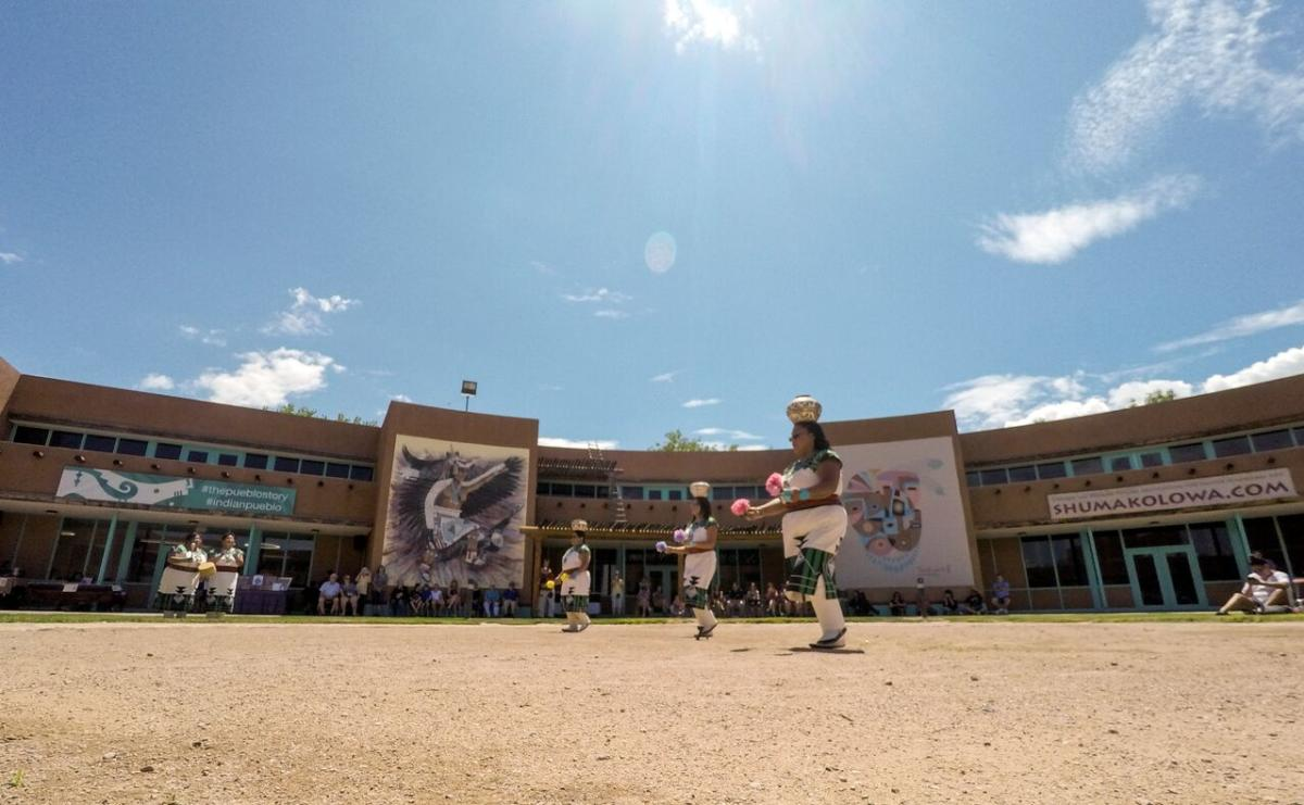Dancers perform outside at Indian Pueblo Cultural Center