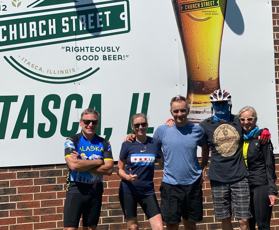 Real Rides group standing in front of a Church Street Brewing Company sign in Itasca, IL