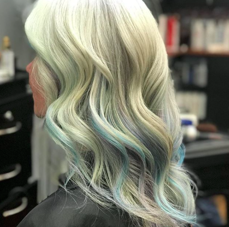 A woman poses with new blonde and blue hair