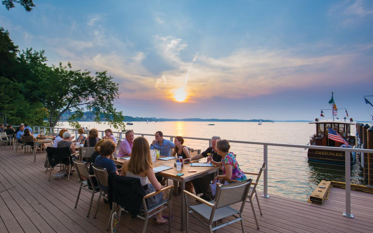 People dining on an outdoor patio at The Edgewater