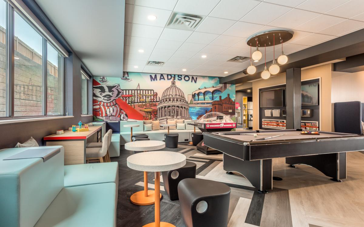 A community room with pool table at Tru by Hilton Madison West