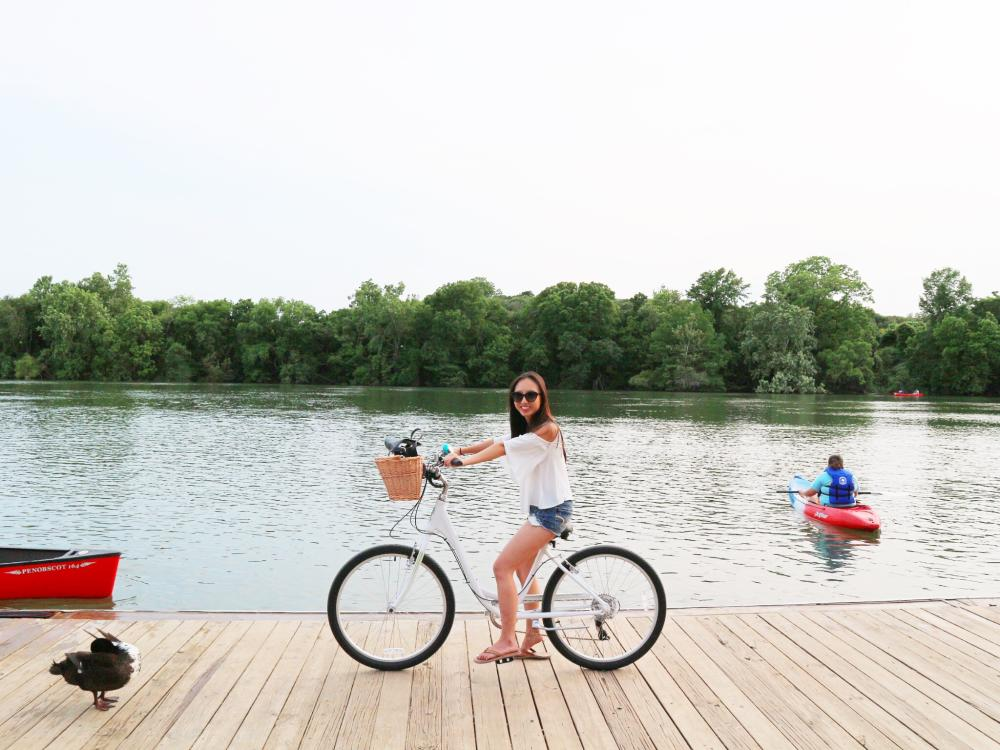 Jane biking on the dock at Lady Bird Lake