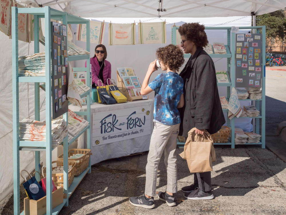 shoppers at annual Cherrywood Art Fair holiday shopping market in austin texas