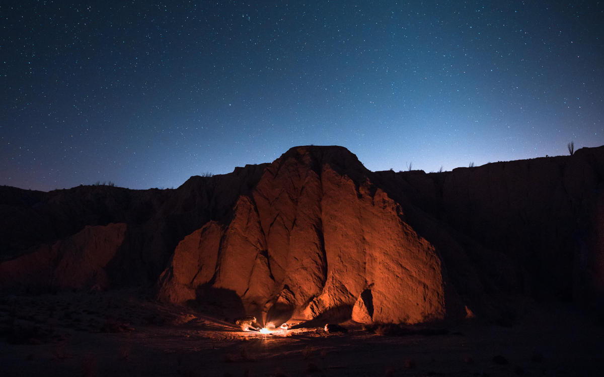 Campers enjoy a fire and stargaze at Anza-Borrego Desert State Park