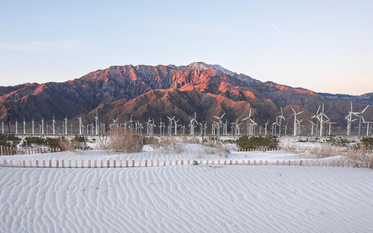 Mount San Jacinto at sunrise with windmills and sand dunes