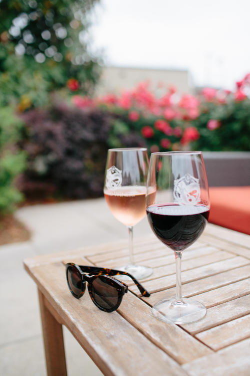 Two glasses of wine and sunglasses at Mermaid Winery