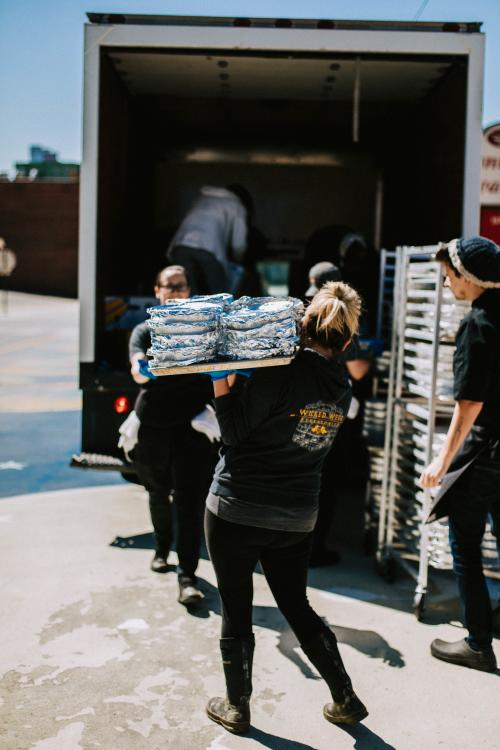 Wicked Weed team members help deliver meals to those less fortunate.