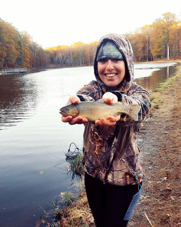 woman holding a bass she caught at Locust Shade Park